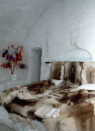 Jukkasjarvi Ice Hotel, Sweden. Bedroom with reindeer blanket