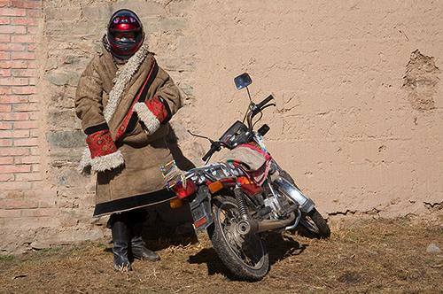 Mongolian nomad with motorbike