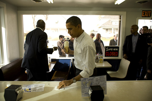 Obama cleaning diner counter, eating ice cream cone, by Callie Shell