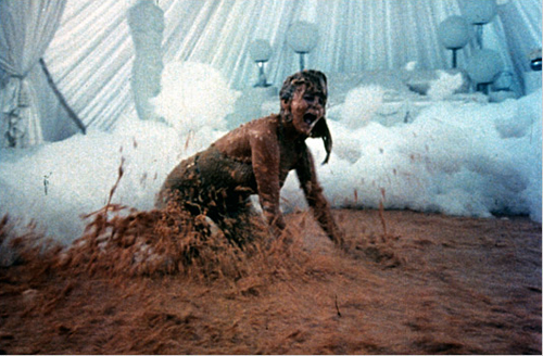 Ann Margret swimming in baked beans, from the movie Tommy, 1975