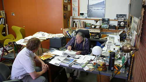 Filmmaker talking to Julius Shulman in his office