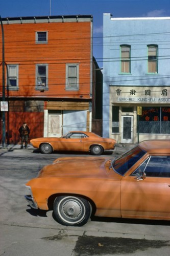 Orange Cars Powell, 1973, by Fred Herzog