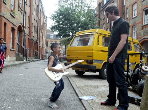 Noel Gallagher with kids in the street
