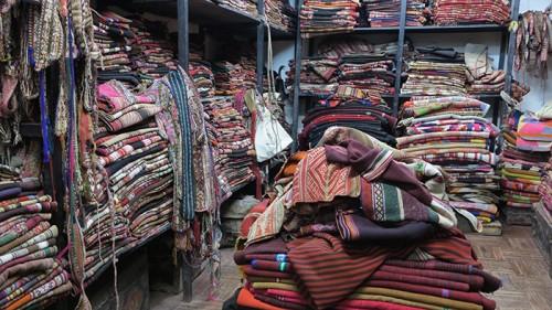 Cuzco - woven mantas in antique weaving shop